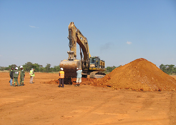 Test pitting with 60 ton excavator.